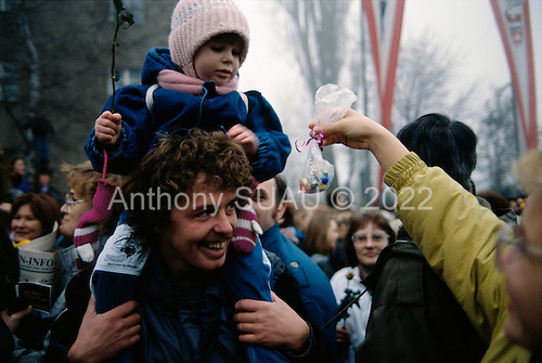 Lichterfelde, Berlin (West) and Teltow, Potsdam (East) crossing post, West Germany<br /> November 14, 1989 <br /> <br /> East and West Germans greet each other with candies, flowers and champaign as they cross the border near the Berlin Wall. Germans gathered as the wall is dismantled and the East German government lifts travel and emigration restrictions to the West on November 9, 1989.