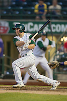 Fort Wayne TinCaps outfielder Michael Gettys (28) follows through on his swing against the West Michigan Whitecaps on May 23, 2016 at Parkview Field in Fort Wayne, Indiana. The TinCaps defeated the Whitecaps 3-0. (Andrew Woolley/Four Seam Images)