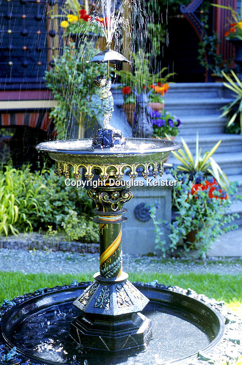 This rare Victorian-era cast-iron birdbath fountain was manufactured in the 1870s by Iske, a well-known nineteenth-century East Coast manufacturer of cast-iron ornamentation. Typical of the late-nineteenth-century Victorian style, the fountain is laden with effervescent decorations, including scampering turtles and frogs. The diagonal bands of color on the column are typical of Eastlake style, while the pointed arches on the upper pan are a nod to Gothic.