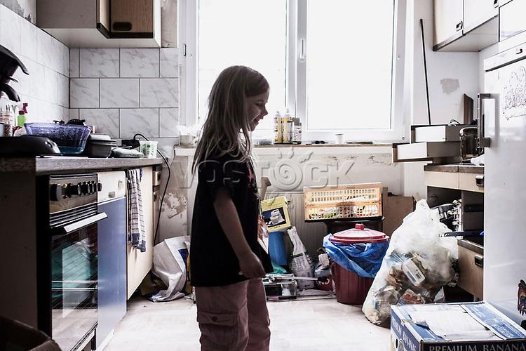 Maedchen in Kueche, Hartz IV, Bochum<br /> <br /> *** HighRes auf Anfrage *** Voe nur nach Ruecksprache mit dem Fotografen *** Sonderhonorar ***<br /> <br /> Engl.: Europe, Germany, Bochum, unemployment benefit, Hartz IV, unemployed, unemployment, poverty, poor, social benefits, child, girl, kitchen, portrait, 20 June 2012<br /> <br /> ***Highres on request***publication only after consultation with the photographer***special fee***