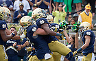 Sept. 26, 2015; Running back C.J. Prosise celebrates a touchdown with teammates in the first quarter against the University of Massachusetts at Notre Dame Stadium. (Photo by Barbara Johnston/University of Notre Dame)