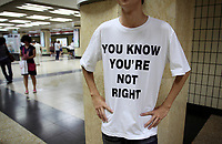 CHINA. In the Beijing subway, a teenager sports a t-shirt with a bold statement. The rise in use of English in China is evident on the streets of Beijing where store-fronts, billboards and clothes frequently sport English words and phrases. 2009