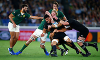 Ardie Savea of NZ is tackled during the Rugby World Cup Pool B match between the New Zealand All Blacks and South Africa Springboks at the International Stadium in Yokohama, Japan on Saturday, 21 September, 2019. Photo: Steve Haag / stevehaagsports.com