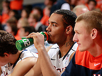 CHARLOTTESVILLE, VA- December 3: Mike Scott #23 of the Virginia Cavaliers watches from the bench during the game on December 27, 2011 against the Longwood Lancers at the John Paul Jones Arena in Charlottesville, Virginia. Virginia defeated Longwood 86-53. (Photo by Andrew Shurtleff/Getty Images) *** Local Caption *** Mike Scott