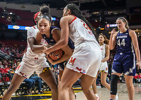 COLLEGE PARK, MD - JANUARY 26: Stephanie Jones #24 and Kaila Charles #5 of Maryland trap Sydney Wood #3 of Northwestern during a game between Northwestern and Maryland at Xfinity Center on January 26, 2020 in College Park, Maryland.