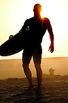 Competitor Mike Barrows from Sea Girt is silhouetted by the setting sun at the start of the 1,000 Meter Paddleboard event at the First Annual Asbury Park Beach Bar Lifeguard Competition held at the 3rd Avenue beach in Asbury Park.  ASBURY PARK, NJ  8/4/07  8:21:47 PM  PHOTO BY ANDREW MILLS