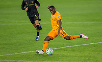 CARSON, CA - OCTOBER 28: Maynor Figueroa #15 of the Houston Dynamo sends a crossing ball during a game between Houston Dynamo and Los Angeles FC at Banc of California Stadium on October 28, 2020 in Carson, California.