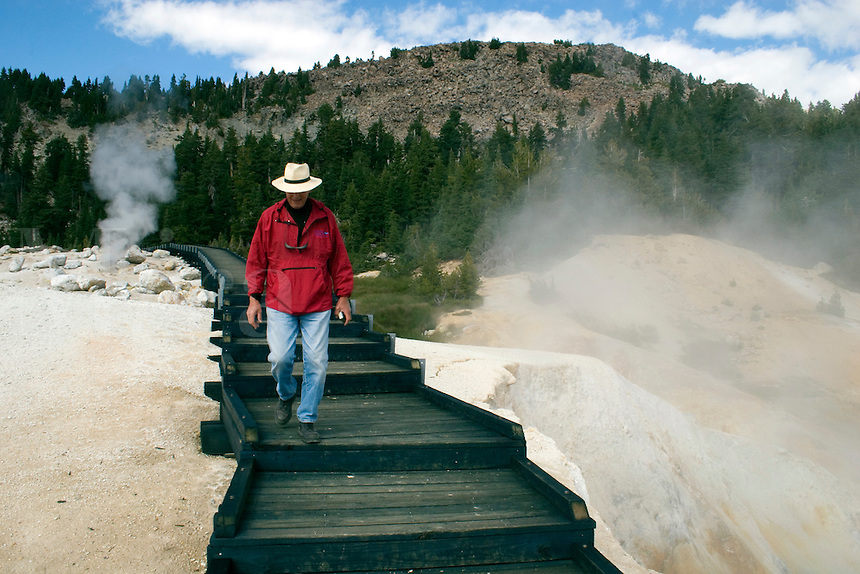 Steam engulfs visitors on a wooden pathway at the hot sulphur springs of BUMPASS HELL - LASSEN NATIONAL PARK -  CALIFORNIA