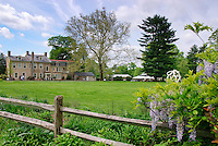 Fordhook Farm Burpee garden and house with wisteria on fence, tent on lawn, historic house, on open tour day
