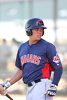 Giovanny Urshela #12 of the Cleveland Indians during a Minor League Spring Training Game against the Cincinnati Reds at the Cincinnati Reds Spring Training Complex on March 25, 2014 in Goodyear, Arizona. (Larry Goren/Four Seam Images)