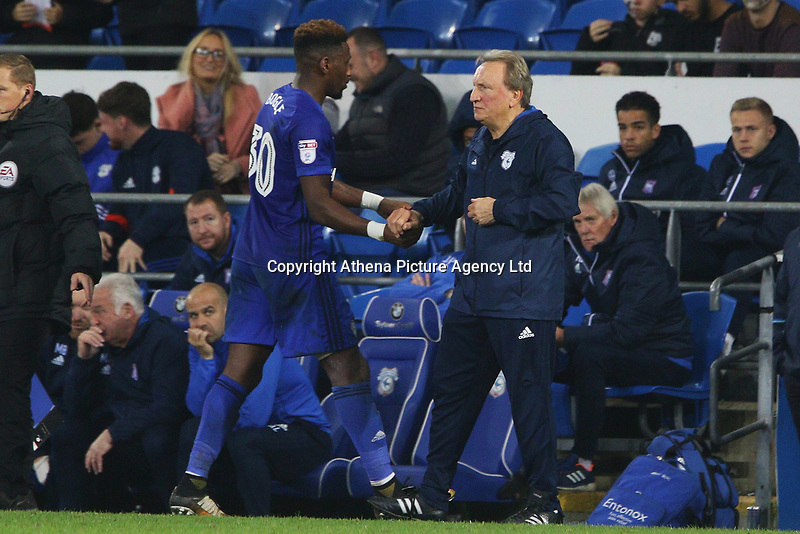 Omar Bogle of Cardiff City shakes hands with Cardiff City manager Neil Warnock during the Sky Bet Championship match between Cardiff City and Ipswich Town at The Cardiff City Stadium, Cardiff, Wales, UK. Tuesday 31 October 2017