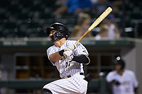 Danny Mendick (17) of the Charlotte Knights follows through on his swing against the Scranton/Wilkes-Barre RailRiders at BB&T BallPark on August 14, 2019 in Charlotte, North Carolina. The Knights defeated the RailRiders 13-12 in ten innings. (Brian Westerholt/Four Seam Images)