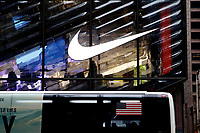 NEW YORK, NEW YORK - FEBRUARY 22: Nike logo is seen on the Nike store, on February 22, 2021 in New York. NIKE, Inc. (NYSE:NKE) will trade ex-dividend in the next days , being NIKE's earnings almost flat over the past five years. (Photo by John Smith/VIEWpress)
