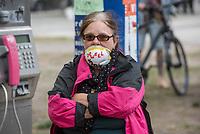 """Auf und rund um den Rosa-Luxemburg-Platz in Berlin-Mitte haben am Samstag den 25. April 2020 mehrere hundert Menschen gegen die Einschraenkungen im Zuge der Massnahmen zur Eindaeemung der Covid-19-Pandemie protestiert. Rechtsextremisten, Hooligans, Antisemiten, Verschwoerungstheoretiker und AfD-Politiker hatten zu einer sogenannten """"Hygiene-Demo"""" versammelt. Vereinzelt protestierten Menschen am Rande gegen diese Demonstration.<br /> Die Polizei war mit mehreren hundert Beamten im Einsatz und nahm mehr als 100 Personen fest.<br /> Im Bild: Eine Demonstrantin traegt eine Mund-Nase-Schutzmaske, auf die sie """"Orwell 1984"""" geschrieben hat.<br /> 25.4.2020, Berlin<br /> Copyright: Christian-Ditsch.de<br /> [NUR FUER REDAKTIONELLE ZWECKE! Werbung nur auf Anfrage beim Fotografen. Inhaltsveraendernde Manipulation des Fotos nur nach ausdruecklicher Genehmigung des Fotografen. Vereinbarungen ueber Abtretung von Persoenlichkeitsrechten/Model Release der abgebildeten Person/Personen liegen nicht vor. NO MODEL RELEASE! Don't publish without copyright Christian-Ditsch.de, Veroeffentlichung nur mit Fotografennennung, sowie gegen Honorar, MwSt. und Beleg. Konto: I N G - D i B a, IBAN DE58500105175400192269, BIC INGDDEFFXXX, Kontakt: post@christian-ditsch.de<br /> Bei der Bearbeitung der Dateiinformationen darf die Urheberkennzeichnung in den EXIF- und  IPTC-Daten nicht entfernt werden, diese sind in digitalen Medien nach §95c UrhG rechtlich geschuetzt. Der Urhebervermerk wird gemaess §13 UrhG verlangt.]"""