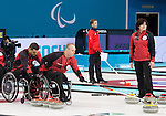 Sochi, RUSSIA - Mar 7 2014 -  Mark Ideson, Dennis Thiessen and Wendy Morgan of Canada's Wheelchair Curling Team trains before the Sochi 2014 Paralympic Winter Games in Sochi, Russia.  (Photo: Matthew Murnaghan/Canadian Paralympic Committee)