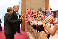 President Trump's Trip to Vietnam<br /> <br /> President Donald J. Trump and Nguyen Xuan Phuc, Prime Minister of the Socialist Republic of Vietnam, are greeted by schoolchildren waving U.S. and Vietnam flags the Office of Government Hall Wednesday, Feb. 27, 2019, in Hanoi. (Official White House Photo by Shealah Craighead)