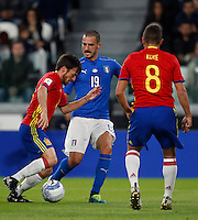 Spain Jordi Alba, left, is challenged by Italy Leonardo Bonucci, center, past Spain Koke during the Fifa World Cup 2018 qualification soccer match between Italy and Spain at Turin's Juventus Stadium, October 6, 2016. The game ended 1-1.<br /> UPDATE IMAGES PRESS/Isabella Bonotto