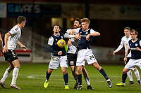 16th March 2021; Dens Park, Dundee, Scotland; Scottish Championship Football, Dundee FC versus Ayr United; Joe Chalmers of Ayr United challenges for the ball with Danny Mullen and Max Anderson of Dundee