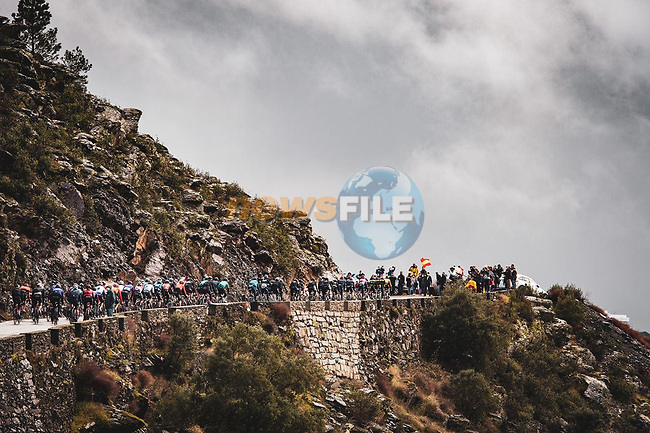 The peloton climb into the clouds during Stage 17 of the Vuelta Espana 2020, running 178.2km from Sequeros to Alto de la Covatilla, Spain. 7th November 2020.  <br /> Picture: Unipublic/Charly Lopez | Cyclefile<br /> <br /> All photos usage must carry mandatory copyright credit (© Cyclefile | Unipublic/Charly Lopez)