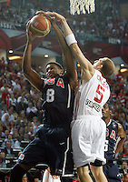 Rudy GAY (USA) jumps for the ball with Sinan GULER (Turkey) during the Final World championship basketball match against Turkey in Istanbul, Turkey-USA, Turkey on Sunday, Sep. 12, 2010. (Novak Djurovic/Starsportphoto.com) .