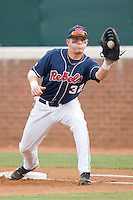 First baseman Mike Snyder #32 of the Ole Miss Rebels fields a throw against the Virginia Cavaliers at the Charlottesville Regional of the 2010 College World Series at Davenport Field on June 5, 2010, in Charlottesville, Virginia.  The Cavaliers defeated the Rebels 13-7.  Photo by Brian Westerholt / Four Seam Images