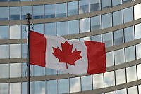 Canadian Flag flying in front of the Toronto City Hall, Toronto, Ontario, Canada