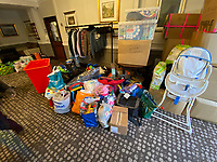 BNPS.co.uk (01202 558833)<br /> Pic: BrianPlatt/BNPS<br /> <br /> Pictured: Donations for refugees.<br /> <br /> A flood of donations for Afghan refugees has inundated a church which has been left with a 24ft long stack of parcels.<br /> <br /> Ross Donaldson posted on a Facebook community group asking if anyone had clothes to offer, sparking an overwhelming response from his community.<br /> <br /> After organising to keep donations at Immanuel Church, Bournemouth, Dorset, he arrived the next morning to find a pile of bags.