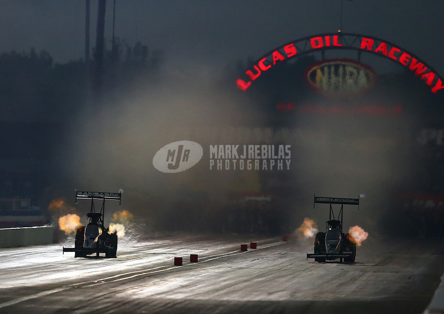 Aug 30, 2014; Clermont, IN, USA; NHRA top fuel dragster driver Brittany Force (right) races alongside Dom Lagana during qualifying for the US Nationals at Lucas Oil Raceway. Mandatory Credit: Mark J. Rebilas-USA TODAY Sports