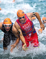 29 JUN 2014 - CHICAGO, USA - Javier Gomez (ESP) (right) of Spain and Stefan Zachaeus (left) leaves the water at the end of the first swim lap during the elite men's ITU 2014 World Triathlon Series round in Grant Park, Chicago in the USA (PHOTO COPYRIGHT © 2014 NIGEL FARROW, ALL RIGHTS RESERVED)