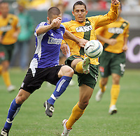 Wade Barrett of the Quakes tangles for the ball against Hurculez Gomez of the LA Galaxy during the MLS Western Conference playoffs at the Home Depot Center October 23, 2005.