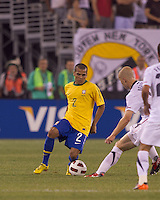 Brazil defender Daniel Alves (2) dribbles as USA midfielder Michael Bradley (4) defends. Brazil  defeated the US men's national team, 2-0, in a friendly at Meadowlands Stadium on August 10, 2010.