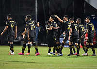 LAKE BUENA VISTA, FL - JULY 18: Mohamed El-Munir #13 of LAFC celebrates his goal with Latif Blessing #7 of LAFC and teammates during a game between Los Angeles Galaxy and Los Angeles FC at ESPN Wide World of Sports on July 18, 2020 in Lake Buena Vista, Florida.