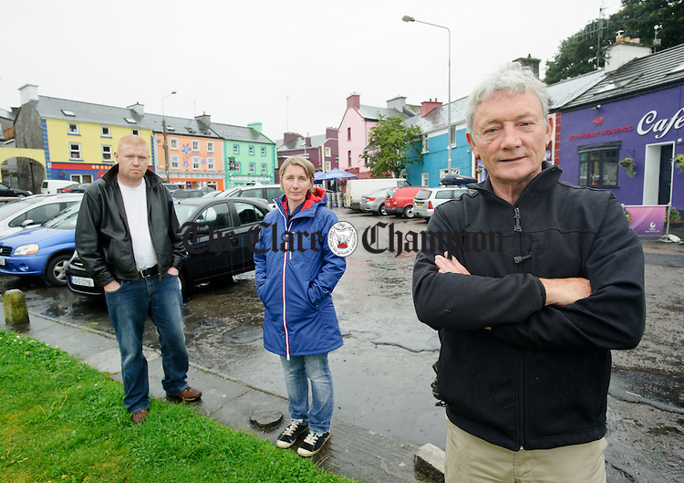 Kinvarra's John Griffin, at right, with Vicky Donnelly and Frank Naughton. Together they have co-ordinated a boycott of Israeli goods in relevant businesses in the village. Photograph by John Kelly.