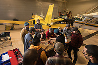 Aviation Maintenance students learn to work on control cables on a donated Piper Cherokee at UAA's Aviation Technology Complex on Merrill Field.