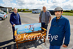 Artist Liam Gunn standing at his painting of a stag, which is painted on a bench made by the Tralee Men's Shed workers. Front right: Liam Gunn. Back l to r: Tom Moloney and Tony McMahon.