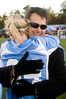 North Carolina Tar Heels head coach Anson Dorrance celebrates with defender Mandy Moraca (34) after the game. The North Carolina Tar Heels defeated the Notre Dame Fighting Irish 2-1 during the finals of the NCAA Women's College Cup at Wakemed Soccer Park in Cary, NC, on December 7, 2008. Photo by Howard C. Smith/isiphotos.com