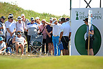 Philip Golding of England drops his ball before playing his shot alongside spectators on the side of 9th green during day one of The Senior Open Golf Tournament at The Royal Porthcawl Golf Club in South Wales this afternoon.