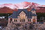 an historic landmark, St. Catherine of Sienna Chapel, below Mt. Meeker at sunrise along the Peak to Peak Scenic and Historic Byway near Estes Park in the Rocky Mountains of Colorado, USA