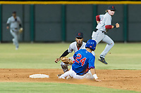 AZL Indians 2 second baseman Gionti Turner (10) applies the tag to Reivaj Garcia (24) on a stolen base attempt during an Arizona League game against the AZL Cubs 2 at Sloan Park on August 2, 2018 in Mesa, Arizona. The AZL Indians 2 defeated the AZL Cubs 2 by a score of 9-8. (Zachary Lucy/Four Seam Images)