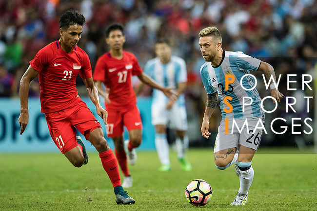 Alejandro Gomez of Argentina (R)  in action against Safuwan Baharudin of Singapore (L) during the International Test match between Argentina and Singapore at National Stadium on June 13, 2017 in Singapore. Photo by Marcio Rodrigo Machado / Power Sport Images