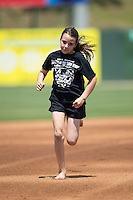 A young fan runs the bases between innings of the South Atlantic League game between the Lakewood BlueClaws and the Kannapolis Intimidators at Kannapolis Intimidators Stadium on May 8, 2016 in Kannapolis, North Carolina.  The Intimidators defeated the BlueClaws 3-2.  (Brian Westerholt/Four Seam Images)