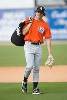 Ryan Berry #39 of the Delmarva Shorebirds carries a bag of baseballs during batting practice at Fieldcrest Cannon Stadium May 12, 2010, in Kannapolis, North Carolina.  Photo by Brian Westerholt / Four Seam Images