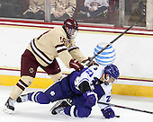 Michael Sit (BC - 18), Brett Lubanski (HC - 21) - The visiting College of the Holy Cross Crusaders defeated the Boston College Eagles 5-4 on Friday, November 29, 2013, at Kelley Rink in Conte Forum in Chestnut Hill, Massachusetts.