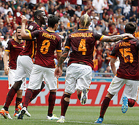 Calcio, Serie A: Roma vs ChievoVerona. Roma, stadio Olimpico, 8 maggio 2016.<br /> Roma's Radja Nainggolan, second from right, celebrates with teammates, from left, Alessandro Florenzi, Antonio Ruediger, Diego Perotti and Miralem Pjanic, right, after scoring during the Italian Serie A football match between Roma and ChievoVerona at Rome's Olympic stadium, 8 May 2016.<br /> UPDATE IMAGES PRESS/Isabella Bonotto