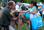 CCSO Reserve Deputy Dave Phillips lets Hennessy Tripp, 6, pet Tarzan during the 11th annual National Night Out hosted by the Carson City Sheriff's Office in Carson City, Nev., on Tuesday, Aug. 6, 2013. <br /> Photo by Cathleen Allison