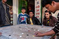 Nepal, Kathmandu.  Boys Playing a Game.