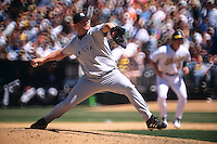 OAKLAND, CA - Roger Clemens of the New York Yankees pitches during a game against the Oakland Athletics at the Oakland Coliseum in Oakland, California in 2003. Photo by Brad Mangin