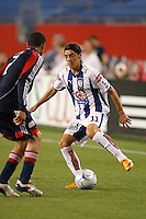 Pachuca CF forward Jose Maria Cardenas (11) and New England Revolution defender Amaechi Igwe (2). The New England Revolution defeated Pachuca CF 1-0 during a Group B match of the 2008 North American SuperLiga at Gillette Stadium in Foxborough, Massachusetts, on July 16, 2008.