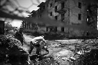 "Nagorny-Karabach, 13.05.2011, Shushi. Arbeiter an einer Baustelle in Schuschi. ""The Twentieth Spring"" - ein Portrait der s¸dkaukasischen Stadt Schuschi, 20 Jahre nach der Eroberung der Stadt durch armenische K?mpfer 1992 im B¸gerkrieg um die Unabh?ngigkeit Nagorny-Karabachs (1991-1994). Labour at a construction site in Shushi. ""The Twentieth Spring"" - A portrait of Shushi, a south caucasian town 20 years after its ""Liberation"" by armenian fighters during the civil war for independence of Nagorny-Karabakh (1991-1994). .Travail sur un chantier à Chouchi. ""Le Vingtieme Anniversaire"" - Un portrait de Chouchi, une ville du Caucase du Sud 20 ans après sa «libération» par les combattants arméniens pendant la guerre civile pour l'indépendance du Haut-Karabakh (1991-1994)..© Timo Vogt/Est&Ost, NO MODEL RELEASE !!"