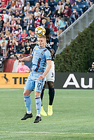 FOXBOROUGH, MA - SEPTEMBER 29: Gary Mackay-Steven #17 of New York City FC and Jalil Anibaba #3 of New England Revolution compete for a high ball during a game between New York City FC and New England Revolution at Gillettes Stadium on September 29, 2019 in Foxborough, Massachusetts.